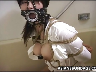 Asian bitch with a mouth piece gets used a bit