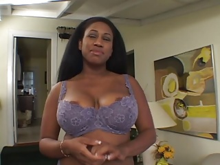 Black chick with huge tits and nipples sucks on white dick