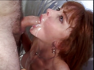 Busty brunette milf gags on hard white cock