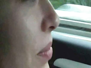Girl masturbates and cums driving down the highway