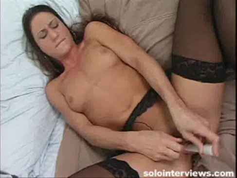 See how she moans while working a vibrator on her pussy