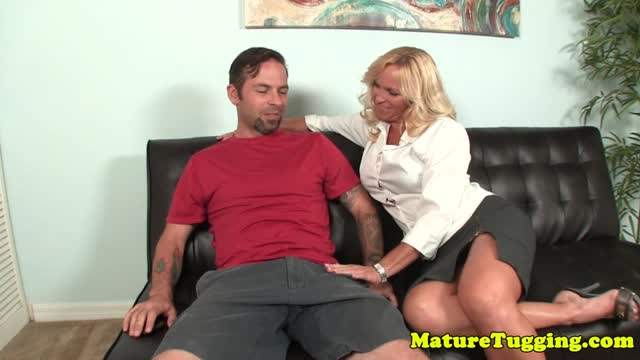 Busty cougar tugging cock and showing tits