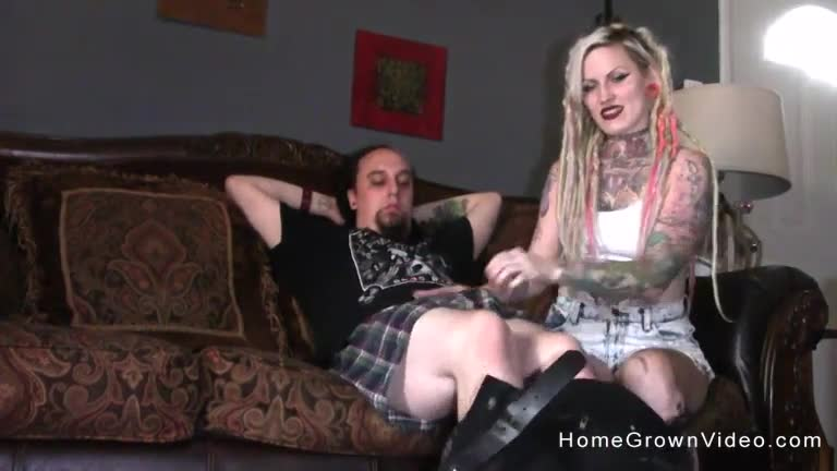 Tattooed wife filming a video while she cheats