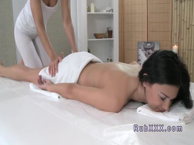 Lesbian babe gets oiled massage