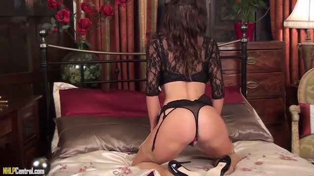 Brunette Milf Nina Leigh entertains you in her tan stockings sexy lingerie masturbating pussy