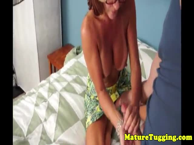 Busty milf with piercing tugs before cumshot