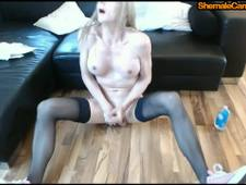 Beautiful blonde shemale in stockings with big tits goes wild