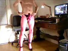 BOB MILGATE COMPLETELY AND TOTALLY EXPOSED WEARING NOTHING BUT PINK FISHNET PANTYHOSE AND HIGH HEELS