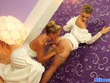 Lesbo brides covered in cum at the gloryhole