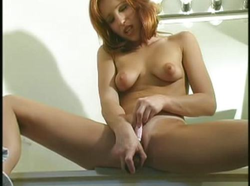 Redhead With Shaved Pussy