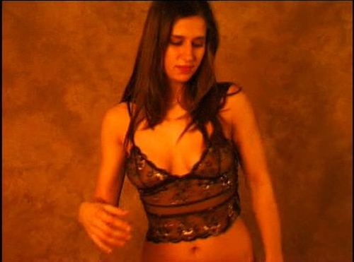 Young Brunette Stripdancing