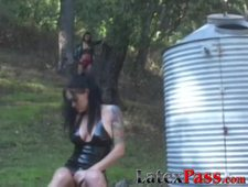 Latex suited Naudia Nyce eaten out by inked dyke outdoors