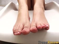 Pretty looking trans babe teases with her feet by the pool